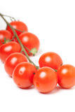 Bunch of Red Cherry Tomatoes on White Background Royalty Free Stock Photography