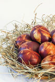 Bunch Of Red Dyed Easter Egg Decorated With Weed Leaves Imprints Set In Hay Nest Detail. Bunch of hand painted Red Easter Eggs, decorated with Weed Leaves Stock Image