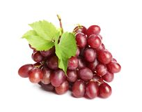 Bunch of red fresh ripe juicy grapes isolated. On white royalty free stock photography
