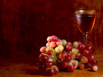 Bunch of red grape and wine glass Stock Photos