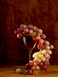 Bunch of red grape and wine glasses Stock Photos