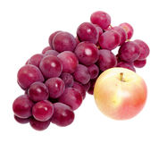 Bunch of red grapes and apple isolated Royalty Free Stock Photography