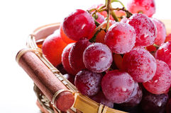 Bunch of red grapes in a basket. Royalty Free Stock Photos