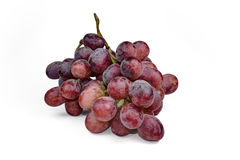 Bunch of red grapes , fresh with water drops.  on white background Royalty Free Stock Images