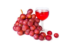 Bunch of red grapes with a glass of wine. On a white background Stock Photo