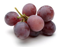 A bunch of red grapes. Isolated on white background Royalty Free Stock Image