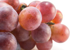 Bunch red grapes macro. On white background Royalty Free Stock Photos