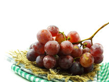 bunch of red grapes on tablecloth Royalty Free Stock Photo