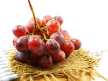 bunch of red grapes on tablecloth Stock Image