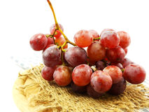 bunch of red grapes on tablecloth Stock Images