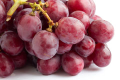 Bunch of red grapes on white surface Stock Image