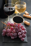 Bunch of red grapes, wine and signboard for the text Stock Photo