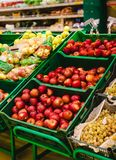 Bunch of red and green apples on boxes in supermarket.  stock photos
