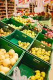 Bunch of red and green apples on boxes in supermarket.  royalty free stock photo