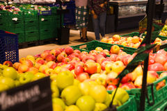 Bunch of red and green apples on boxes in supermarket Royalty Free Stock Images