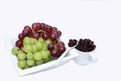 Bunch of red and green grapes and black raisins Royalty Free Stock Photo