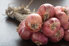 Bunch of red onions on wood. Royalty Free Stock Photos