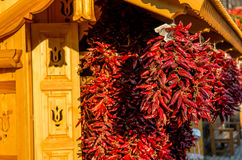 Bunch Of Red Paprika. In front of wooden hut Royalty Free Stock Photography