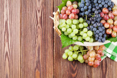 Bunch of red, purple and white grapes in basket Stock Images