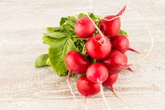Bunch of red radish on a wooden board Stock Photography