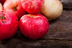 Red ripe apples. Bunch of red ripe apples on the vintage wooden table stock photo