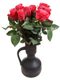 Bunch of red roses in black ceramic jug Stock Photography