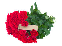 Bunch of red roses with empty tag Royalty Free Stock Photo