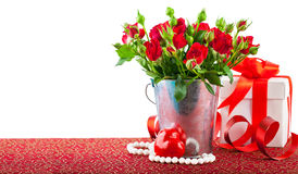 Bunch red roses with gift and heart Royalty Free Stock Image