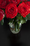 Bunch of red roses in glass vase Royalty Free Stock Photography