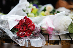 A bunch of red roses under a rain Stock Images