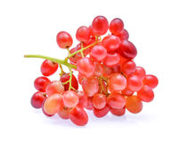 Bunch red seedless crimson grape isolated on white Royalty Free Stock Photo
