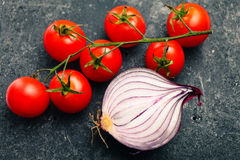 Bunch red tomatoes and red onion Royalty Free Stock Images