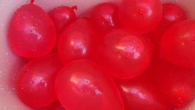 Red water balloons Royalty Free Stock Images