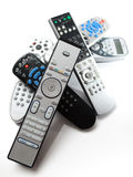 Bunch of remotes. A bunch of television remote controls in a pile, isolated on white Stock Photos