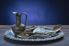 Bunch of retro tableware on a kitchen table Royalty Free Stock Photos