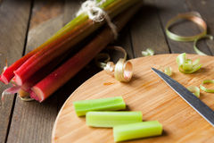 Bunch of rhubarb and pieces on the board Stock Photo
