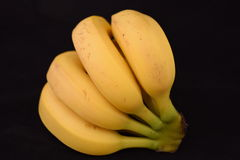 Bunch of Ripe Bananas. Bunch of ripe bananas isolated on a black background Stock Photo