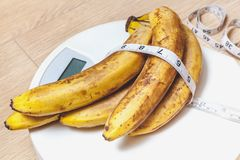 Bunch of bananas lying on floor scales Stock Image