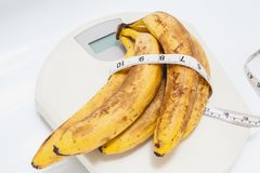 Bunch of bananas lying on floor scales on white background Royalty Free Stock Image