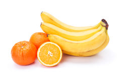 Bunch of ripe bananas and oranges royalty free stock photo