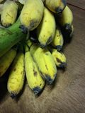 Bunch of ripe bananas. On a wooden surface stock photos