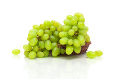 Bunch of ripe green grapes with reflection on white background Stock Photography