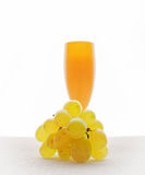 Bunch of ripe and juicy green grapes close-up in wine glass on a Stock Images