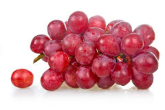 Bunch of ripe pink grapes isolated Royalty Free Stock Photography