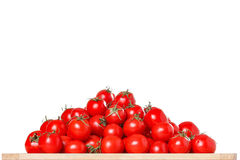 Bunch of ripe red tomatoes on a white Stock Image