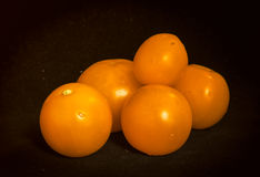 A bunch of ripe tomatoes orange Stock Photography