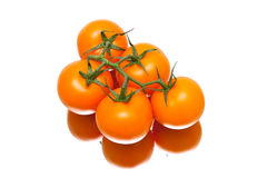 Bunch of ripe tomatoes on a white background with reflection stock photos