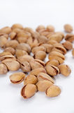 A bunch of roasted pistachios on a white background Stock Photo