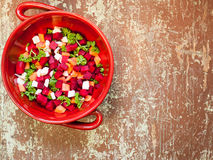 Bunch of root vegetable. Clay bowl full of fresh vegetable salad Stock Images