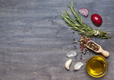Bunch of rosemary, condiment and olive oil on the wooden backgro Royalty Free Stock Photos